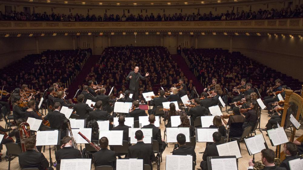 The orchestra performing at Carnegie Hall